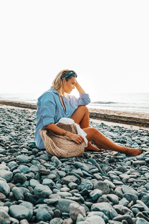 Basti_Kaspar-people-girl-red-dress-beach-stone